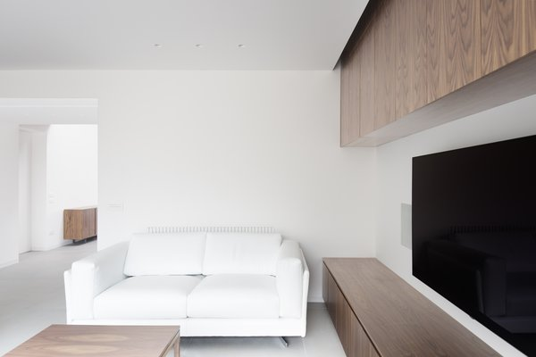 even in the living the dark walnut furniture has been designed by the architects Photo 2 of Home A236 modern home