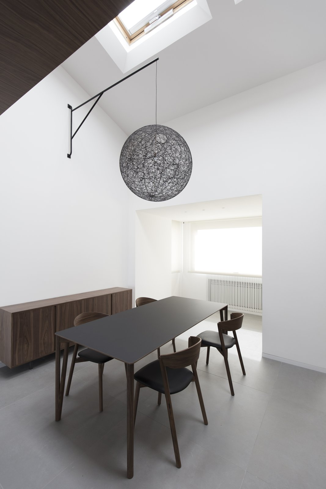 "The lamp is suspended over the table thanks  to this"" iron arm"" designed ad hoc  Home A236 by Elena Morgante"