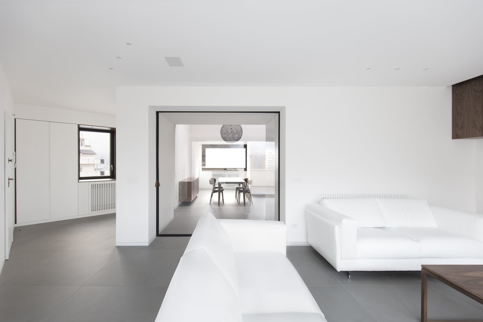 the living room the dining room can be separated through a glazed sliding door  Home A236 by Elena Morgante