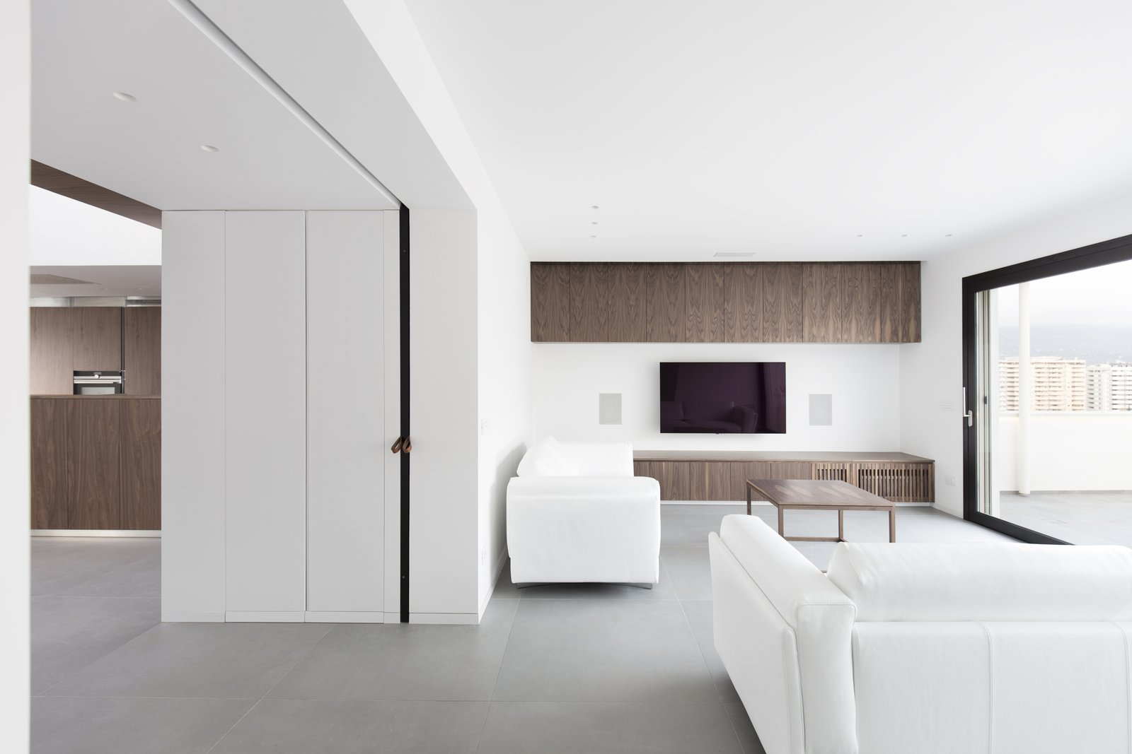 even in the living the dark walnut furniture has been designed by the architects  Home A236 by Elena Morgante