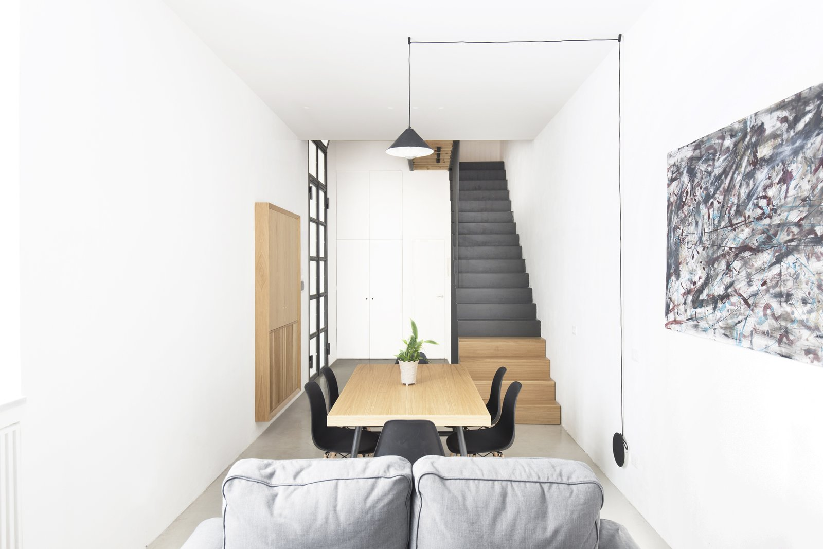 All furniture is made of oak wood except the staircase volume made entirely of black steel. Tagged: Living Room, Chair, Sofa, Ceiling Lighting, Floor Lighting, Table Lighting, and Pendant Lighting.  Best Photos from EXISTENZ MINIMUM- Palermo House A223