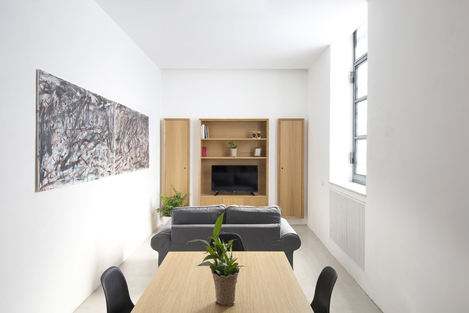 The wall unit, the built in closet are conceived as functional elements and partialy built into walls to save space. Tagged: Living Room, Sofa, and Pendant Lighting.  Best Photos from EXISTENZ MINIMUM- Palermo House A223