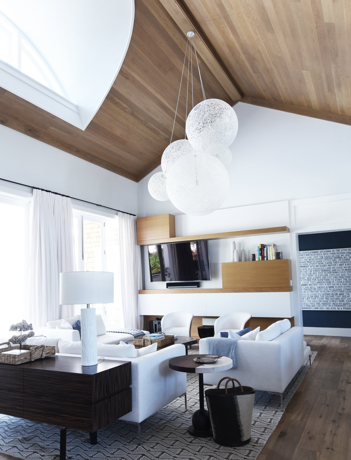 Great Room Tagged: Living, Sofa, Bookcase, Coffee Tables, Chair, Console Tables, End Tables, Ceiling, Floor, Pendant, Medium Hardwood, and Table.  Best Living Console Tables End Tables Photos from Bahamian Retreat