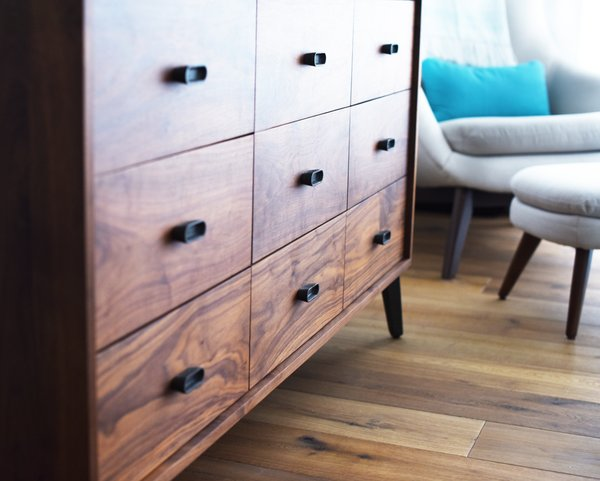 Modern home with bedroom, dresser, and chair. Guest Bedroom Dresser Detail Photo 14 of Bahamas Style