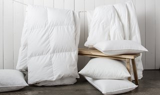How to Care for Your Bedding - Photo 2 of 5 - It's important that Down Duvets dry completely after washing before you put them back on your bed or storage; Source: Nicole LaMotte/Parachute
