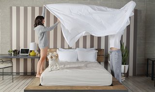 How to Care for Your Bedding - Photo 4 of 5 - Folding's more fun when tackled together; Source: Bethany Neuart/Parachute