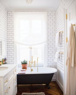 How to Prepare Your Bathroom for Overnight Guests - Photo 3 of 8 - Go the extra mile and provide a robe for your guests; Source: Roomed