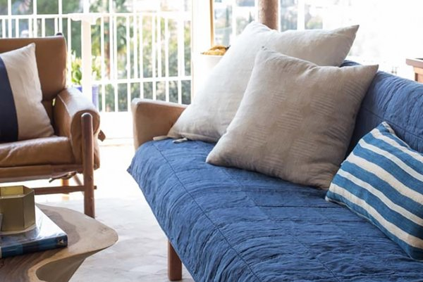 Stylist Emily Henderson shows how to style an Essential Quilt on a couch; Source: Jess Isaac/Styled by Emily Henderson