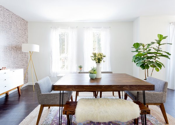 Dining table and bench: custom. Chanel Dining Chairs: Article. Mid-Century Tripod Floor lamp: West Elm. Tejn Faux Sheep Skin: Ikea; Source: Amy Bartlam/Parachute