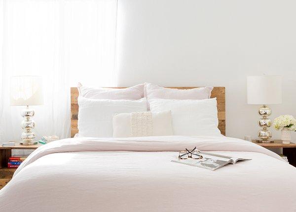 Blush Linen Bedding: Parachute. Blush Linen Euro Shams: Parachute. White Linen Pillowcases: Parachute. Emerson Reclaimed Wood Nightstands: West Elm. Abacus Table Lamps: West Elm; Source: Amy Bartlam/Parachute