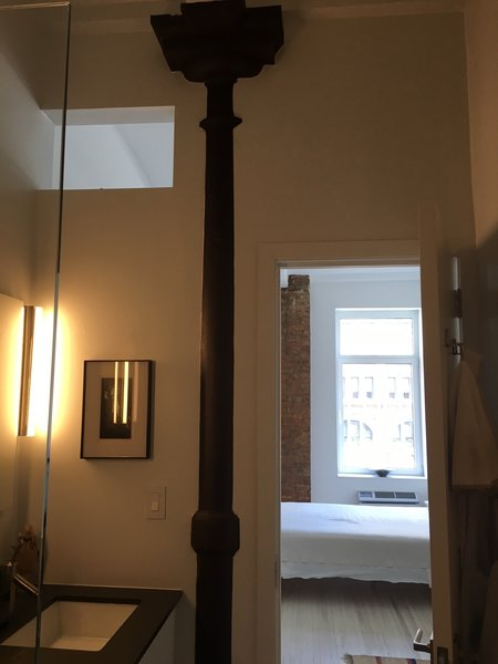We incorporated the columns in the bathroom wall.  Photo 4 of My loft in Greenwich Village (New York) modern home