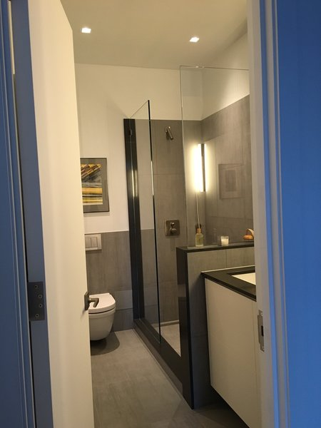 Italian shower. We used the same caesarstone for the kitchen and the bathroom.  Photo 5 of My loft in Greenwich Village (New York) modern home