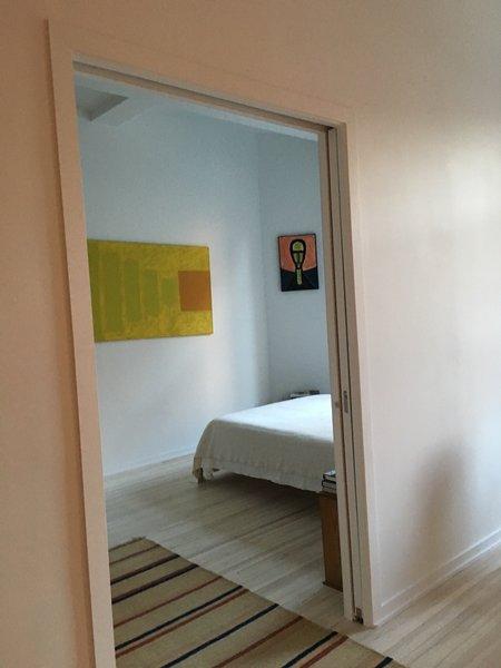 Bedroom seen through oversize pocket door. Photo 6 of My loft in Greenwich Village (New York) modern home
