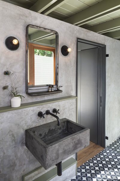 The new casita bathroom features a custom concrete sink, plaster walls, and custom concrete tile. Photo 8 of Garner Pool & Casita modern home
