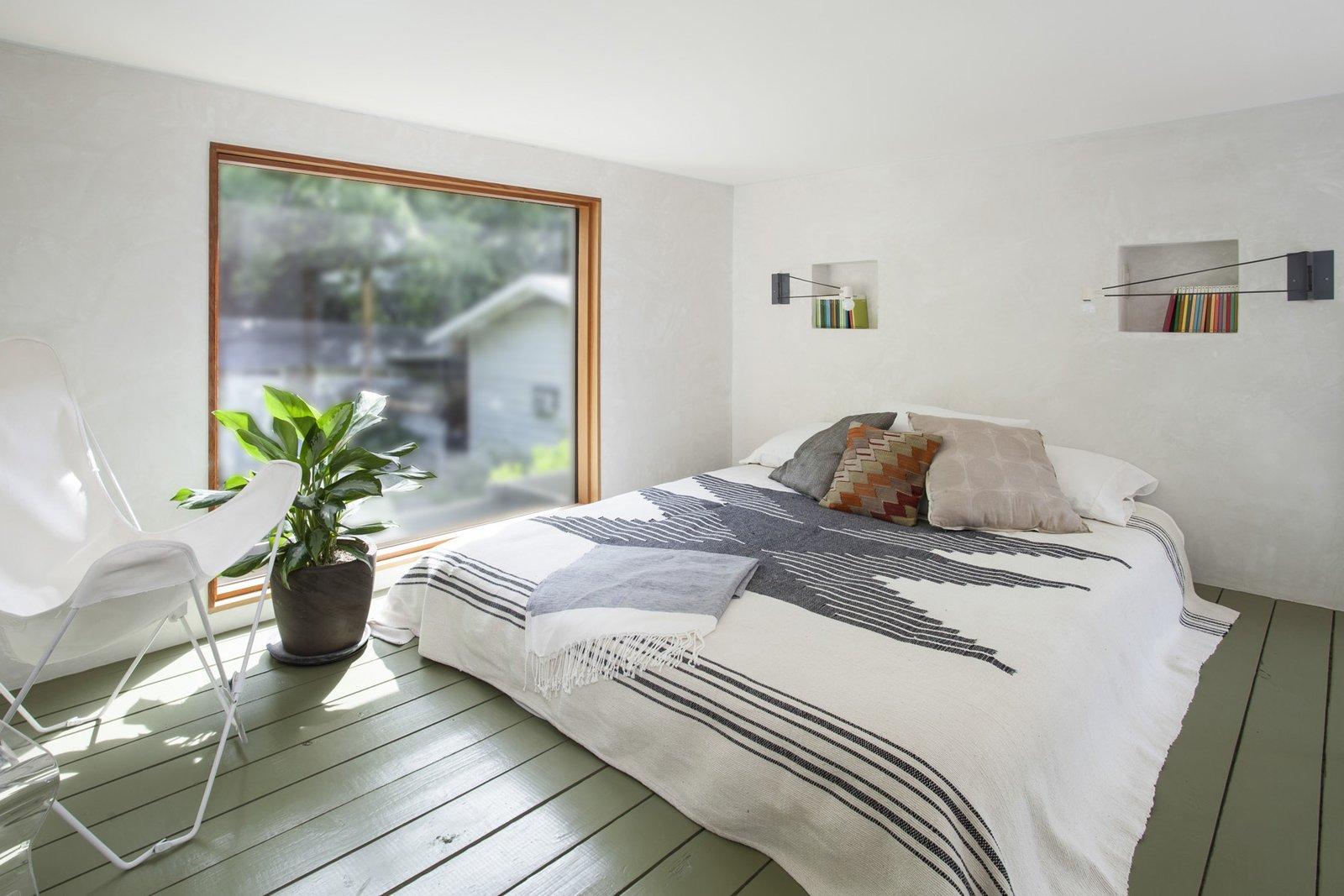 The small sleeping loft integrates plaster niches for storage.  Garner Pool & Casita by Elizabeth Baird