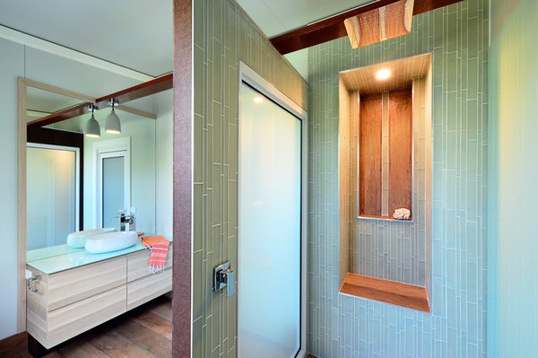 Ensuite... glass tiles, wall panels and benchtops.   Creating beautiful spaces in every room Photo 8 of South Coast Serendipity modern home
