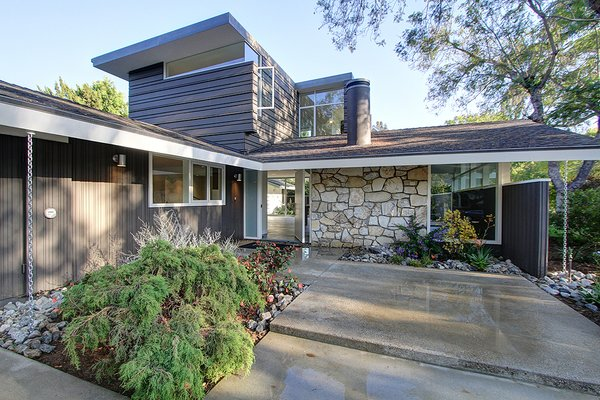 Modern home with horizontal fence, wood fence, garden, front yard, rooftop, woodland, slope, trees, hardscapes, shrubs, boulders, walkways, outdoor, and vertical fence. Front entry Photo 3 of Alpine Street