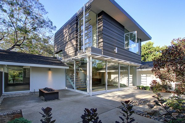 Modern home with wood fence, horizontal fence, front yard, trees, rooftop, garden, woodland, shrubs, hardscapes, boulders, walkways, concrete patio, porch, deck, gardens, and outdoor. Living room garden looking north east   Photo 4 of Alpine Street