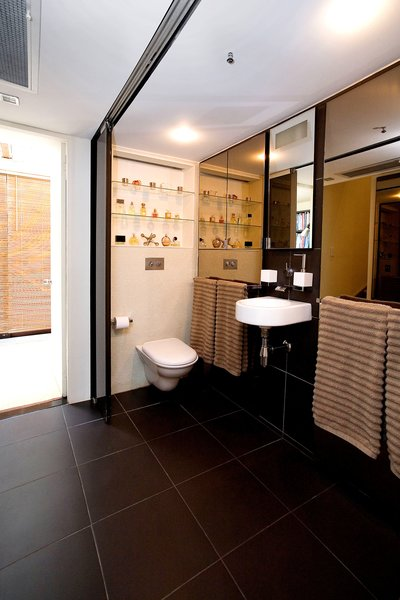 open bathroom (shower behind mirror is enclosed when doors are closed) Photo 4 of Terrace House 1 modern home