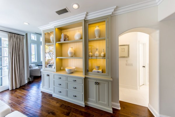 Master bedroom display cabinet for the client's antiquities. Photo  of Modernized English Style modern home