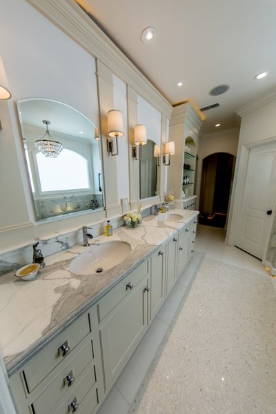 Master bath his and her sinks with tub chandelier reflecting in the mirror. Photo 6 of Modernized English Style modern home