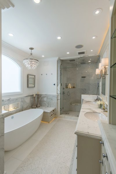 Master bath retreat with spa tub, steam shower, and his and her sinks. There is also a fireplace in the wall at the foot of the tub. Photo 8 of Modernized English Style modern home