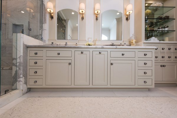 Master bath cabinetry makes a statement with the symmetry and custom hand-beaded inset doors. Photo 9 of Modernized English Style modern home