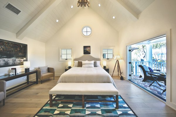 The second master bedroom with vintage French country bed for the ultimate romantic weekend.  Photo  of Streamlined Cape Cod at The Wedge modern home