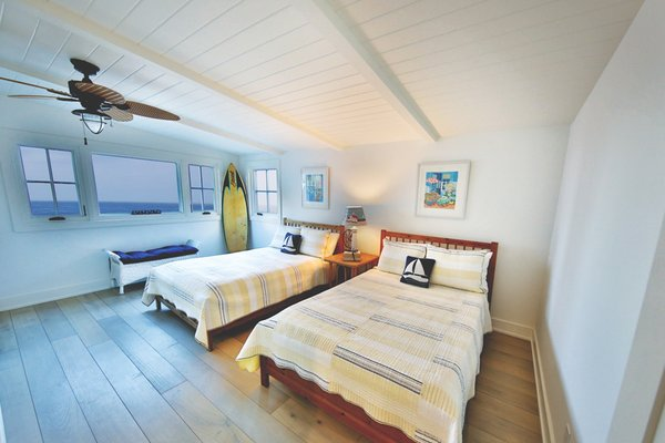 Bright and sunny guest room with casual furnishings and a surfer theme.  Photo 2 of Streamlined Cape Cod at The Wedge modern home