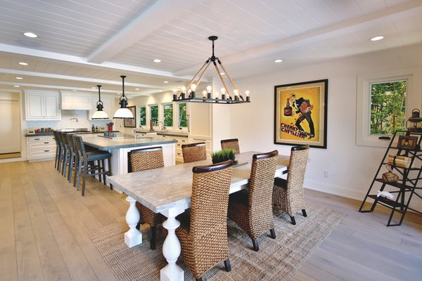 Magnificent open plan kitchen and dining room with extra large Island.  Photo 8 of Streamlined Cape Cod at The Wedge modern home