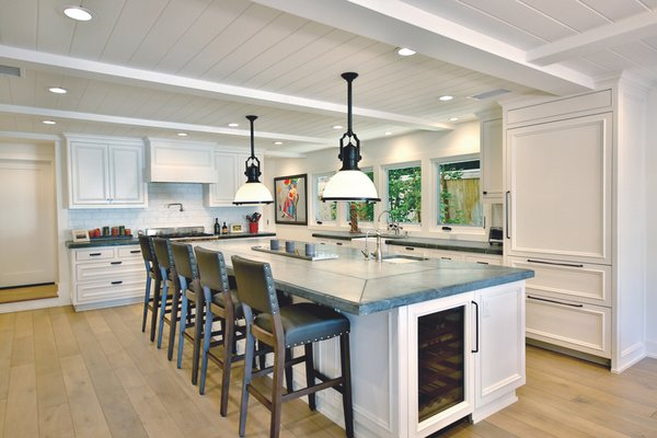 Magnificent open plan kitchen and dining room with extra large Island. Photo 9 of Streamlined Cape Cod at The Wedge modern home
