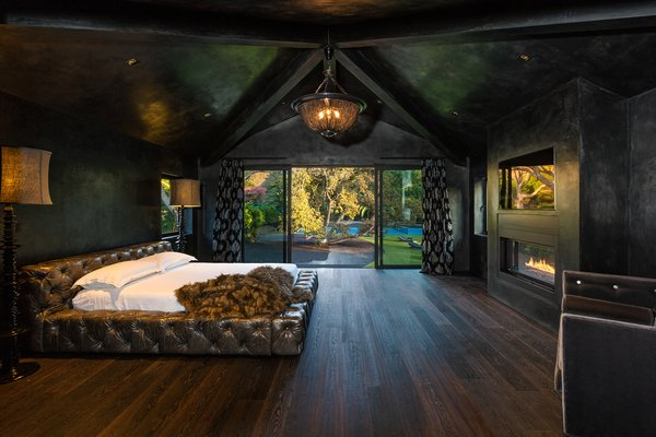 Master bedroom with views of the backyard. Photo 2 of Malibu Lake House modern home