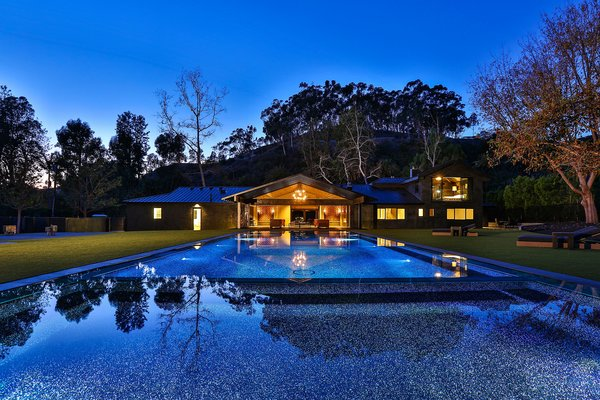View of home from backyard, featuring the infinity pool. Photo 12 of Malibu Lake House modern home