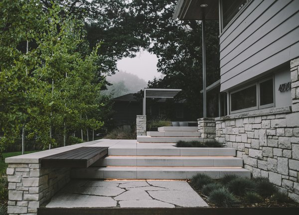 Modern patio extending into the landscape Photo 2 of Twin Lake Residence modern home