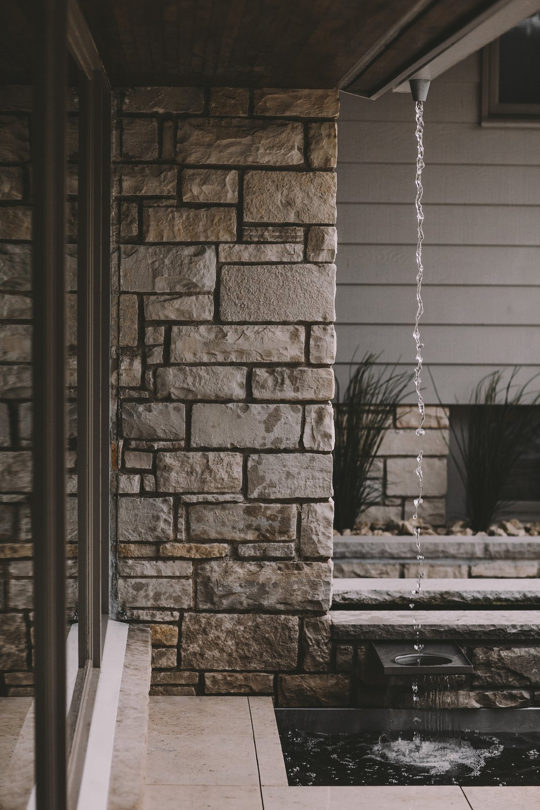 Elegant water feature connecting rainwater with this modern fountain