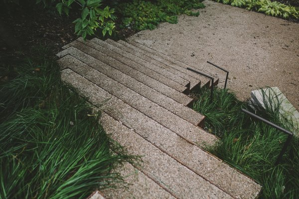 Steel stairs flowing through native grasses Photo 9 of Twin Lake Residence modern home
