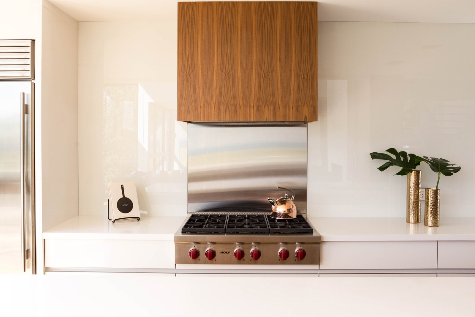 The Sub-Zero and Wolf appliances, which include a fridge, cook top, and a wall oven, were selected for both their performance capabilities, as well as their aesthetic appeal, which suited the contemporary design of the kitchen.