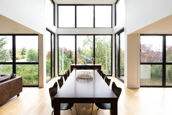 The extensive use of wood on the interiors ties the house back to nature, as views of the ravine in the backyard can be enjoyed through the massive floor-to-ceiling windows along the kitchen and whole rear wall of the home. Photo 6 of Ravine House modern home