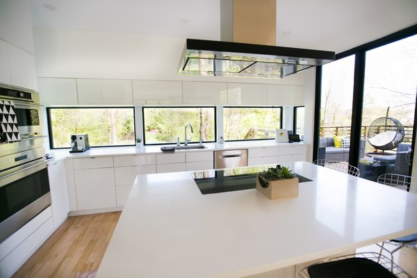Modern kitchen with 180 degree views of the trees and Geist Reservoir Photo 6 of The Sangar House modern home