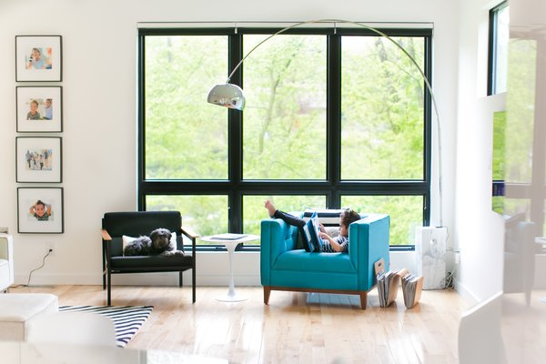 Uncovered windows in the living room gain privacy with the surrounding trees Photo 12 of The Sangar House modern home