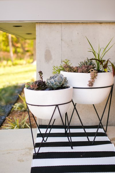 Front porch planters with mid-century modern inspired chevron base Photo 15 of The Sangar House modern home