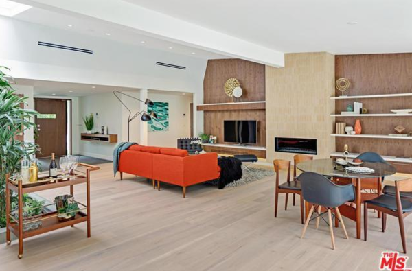 Love the walnut wrapped bookshelves, and the original tile on the fireplace.  That smoked glass vintage dining table and Eames chairs help finish the Mad Man look.  Photo 4 of Studio City MCM Sleeper modern home