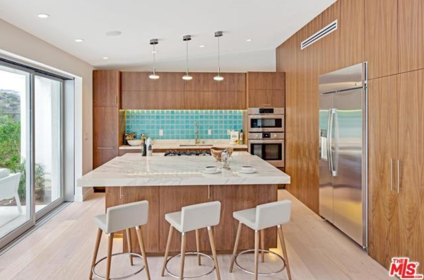 Kitchen with more rich walnut, and that teal tile !! love it  Photo 6 of Studio City MCM Sleeper modern home