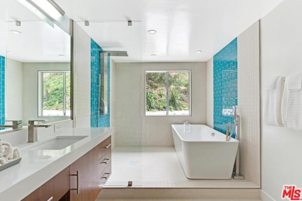 Love the tile, and great solution for a small space - put the tub in the shower !   Photo 10 of Studio City MCM Sleeper modern home