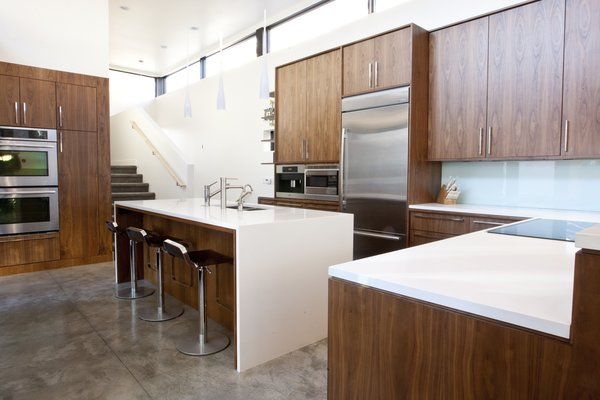 Walnut Kitchen Cabinets by AvenueTwo, Caesarstone Countertops, Jenn-Air Appliances