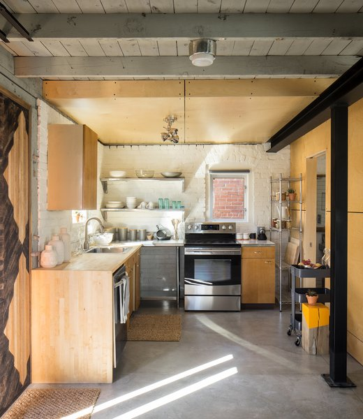 Kitchen Area with lath wall panel. Reuse of kitchen cabinets from a 1950's ranch home. Baltic birch wall and ceiling panels.