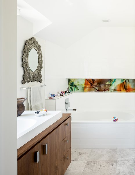 Modern home with bath room, wood counter, porcelain tile floor, alcove tub, open shower, vessel sink, ceiling lighting, and subway tile wall. Guest Bathroom. Niche glass by artist.  Photo 9 of Artist Residence