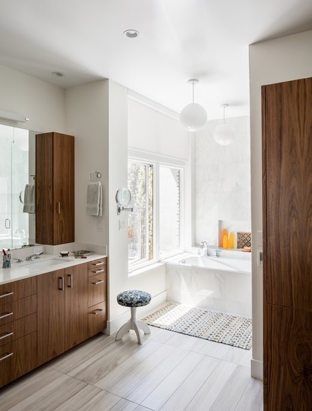 Modern home with bath room, engineered quartz counter, undermount sink, porcelain tile floor, open shower, alcove tub, pendant lighting, and stone tile wall. Master Bathroom.  Photo 11 of Artist Residence