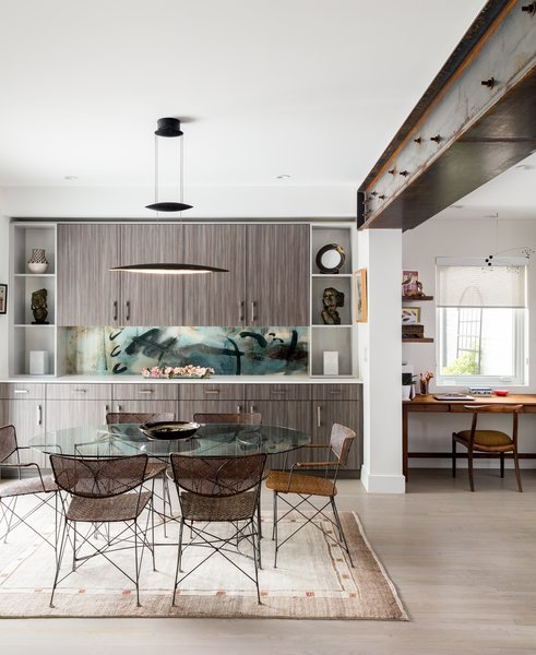 Modern home with dining room, chair, table, ceiling lighting, and light hardwood floor. Dining Area with Bar Beyond. Backsplash by Artist.  Photo 7 of Artist Residence