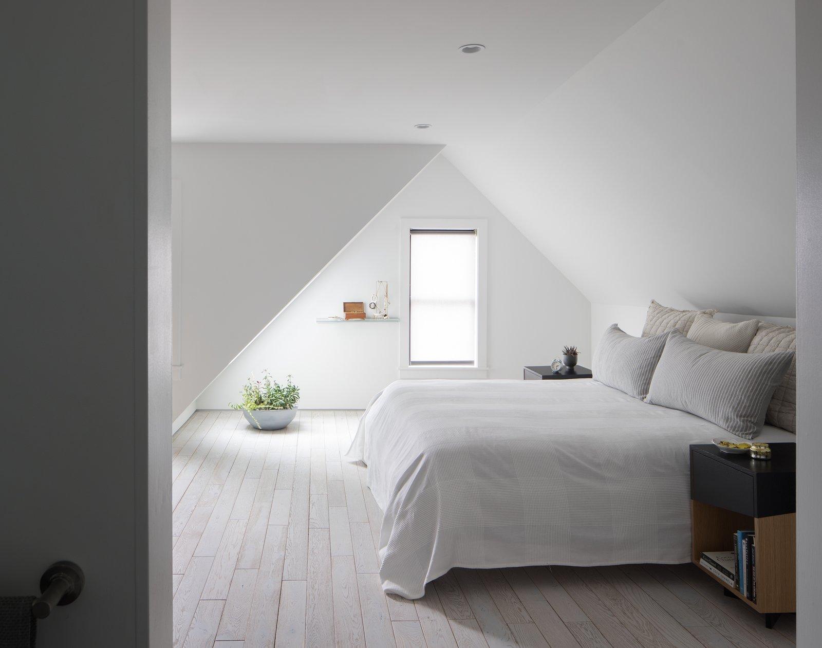 Master Bedroom. Custom night stand by Platform Workshop.  Tagged: Bedroom, Night Stands, Bed, Ceiling Lighting, and Light Hardwood Floor.  Thole Residence by Design Platform